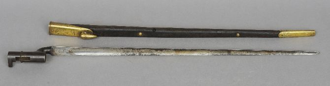 A 19th Century British Army Enfield-Martini bayonet  With brass mounted leather scabbard, with