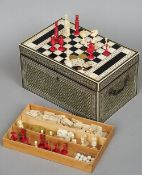 A 19th century Anglo-Indian ivory and ebony inlaid games compendium The rectangular hinged top