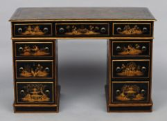 A Victorian pedestal desk With all over chinoiserie decoration, fitted with nine drawers. 104 cm