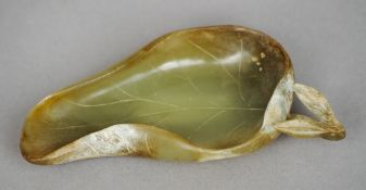 A Chinese carved russet jade brush washer Worked as a leaf.  12.5 cm long. CONDITION REPORTS: