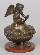A 19th century patinated bronze bowl and cover The domed removable cover surmounted with cupid,
