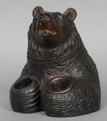 A Blackforest carved inkwell Worked as a bear, the head hinged.  21 cm high. CONDITION REPORTS: