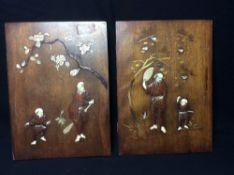 A pair of early 20th century Japanese ivory and bone inlaid panels Each decorated with a father and