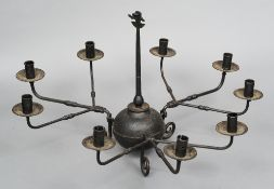 A wrought iron nine branch hanging chandelier 80 cm diameter. CONDITION REPORTS: Generally in good