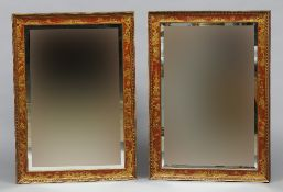 A pair of mirrors Each with bevelled plate within a red ground chinoiserie decorated frame.  75 cm