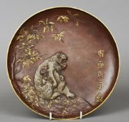 A late 19th century Austrian cold painted bronze plate Decorated in the Japanese style with  monkeys