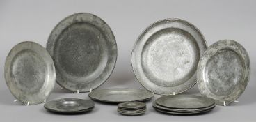 A quantity of pewter dishes Various dates, touch marks and sizes.  The largest 30.5 cm diameter, the