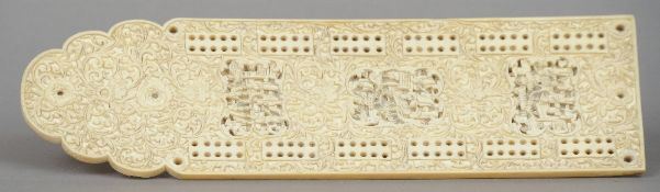 A Chinese Canton carved ivory cribbage board Profusely worked with figural vignettes amongst foliate