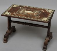 An early 19th century ivory and ebony inlaid yewwood topped side table The rectangular top inlaid
