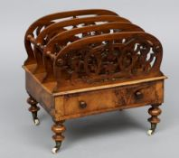 A Victorian burr walnut Canterbury With domed fret carved divisions separated by turned roundels,