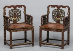 A pair of late 19th century Chinese chinoiserie lacquered open armchairs Each with a carved and