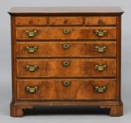 An 18th century style burr walnut chest of drawers The canted rectangular top above three short