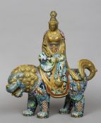 A 19th century cloisonne figure of Guanyin Modelled seated holding a ruyi sceptre and seated on a
