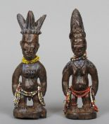 A pair of Amazonian carved figures, possibly Urubu tribe Modelled as a male and female wearing