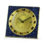 A GILT METAL LACQUERED JAEGER LECOULTRE ALARM TRAVEL CLOCK CIRCA 1970 IN ORIGINAL JLC POUCH D: Two