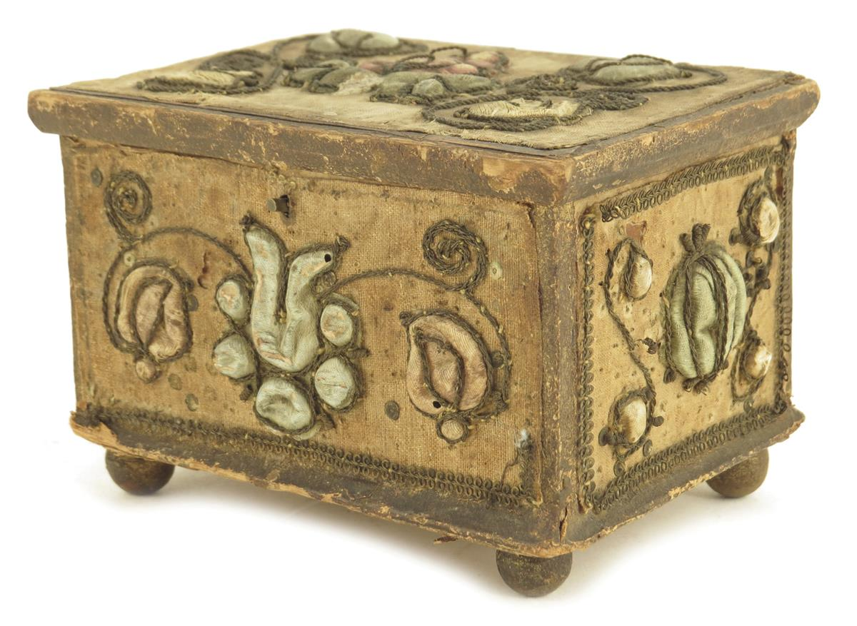 A stumpwork casket, decorated with satin flowers with metal thread scrolls, with a paper lined