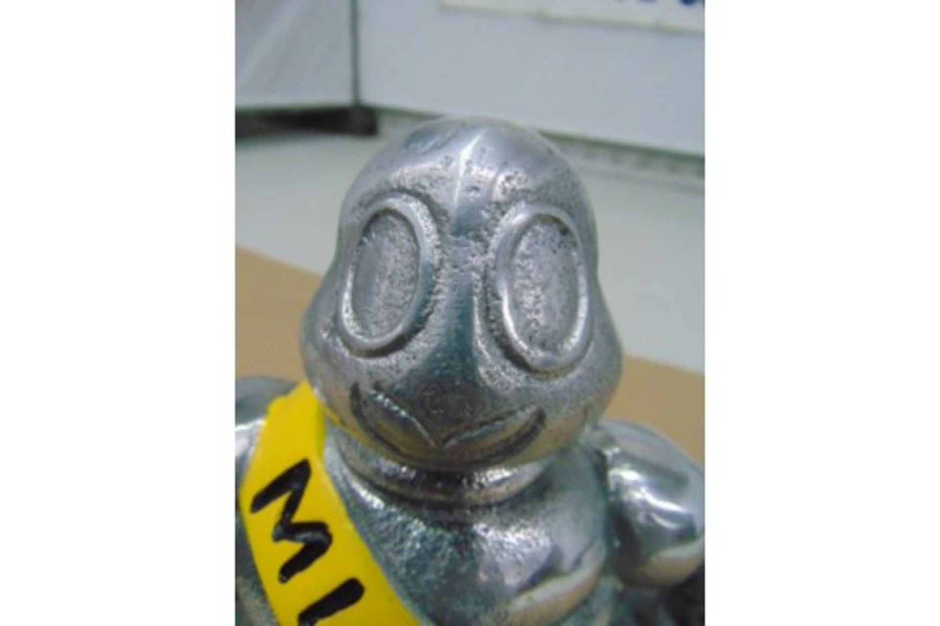 "Lot 26593 - 15"" Polished Aluminium Detroit Reg 1918 Michelin Man"