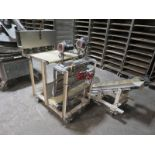 Semi automatic 4 position pizza dough bagger, with cleated belt discharge and mobile base