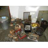 Assortment of various gauges of steel on floor