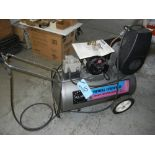 Campbell Hausfeld compressor with additional fittings, manual