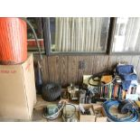 Table with contents (auger, pneumatic tires, books,, tools, sweeping compound, etc)