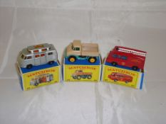 A group of three Matchbox Lesney vehicles to include a number 34 campervan, a number 49 Unimog and a