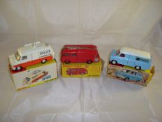 Three boxed Dinky vehicles to include a Police Accident Unit, a Fire Engine and a Kenwood Transit