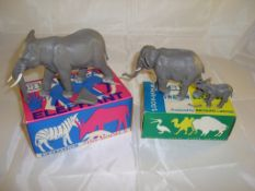 A pair of boxed Britain's plastic elephants, 1310 and 1311. The large elephant has an ear