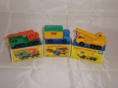 A group of Matchbox construction vehicles to include a number 30 , a number 60 and a number 63. G-VG