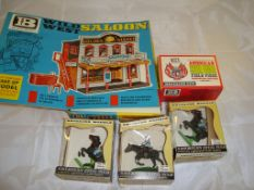 A selection of Britains Wild West toys to include a saloon kit and some horses VG in F-G boxes