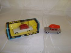 A boxed Vauxhall Cresta together with an unboxed Austin 1100 with red canoe. Both by Spot-On (2) G