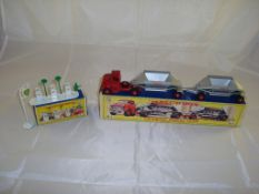 A boxed Matchbox A1 garage forecourt together with a boxed M4 Fruehauf Hopper Train. G-VG in G boxes