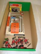 A group of Britains diecast toys to include a boxed garage forecourt set, a boxed motorcyle and a