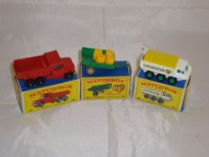 A group of three Matchbox vehicles to include a number 48 dumper truck, a number 61 trailer and a