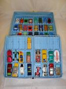 A Matchbox Cars carry case containing a selection of Matchbox, Husky, Corgi and Impy vehicles. F-G