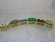 A selection of boxed Matchbox cars to include numbers: 8, 25, 46, 52 and 66 together with an empty