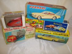 A selection of vintage boxed friction powered vehicles by various manufacturers (mostly Hong Kong)