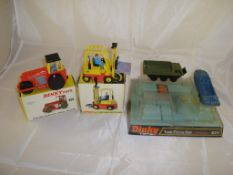 A group of Dinky toys to include a boxed Dinky Aveling-Darford Diesel Roller, a boxed Dinky fork