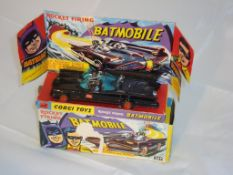 A boxed dieast Corgi 267 Batmobile G-VG in F-G box, with figures, instructions, 7 rockets and