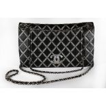 A Chanel black and silver quilted leather bag, modern, stamped to interior,