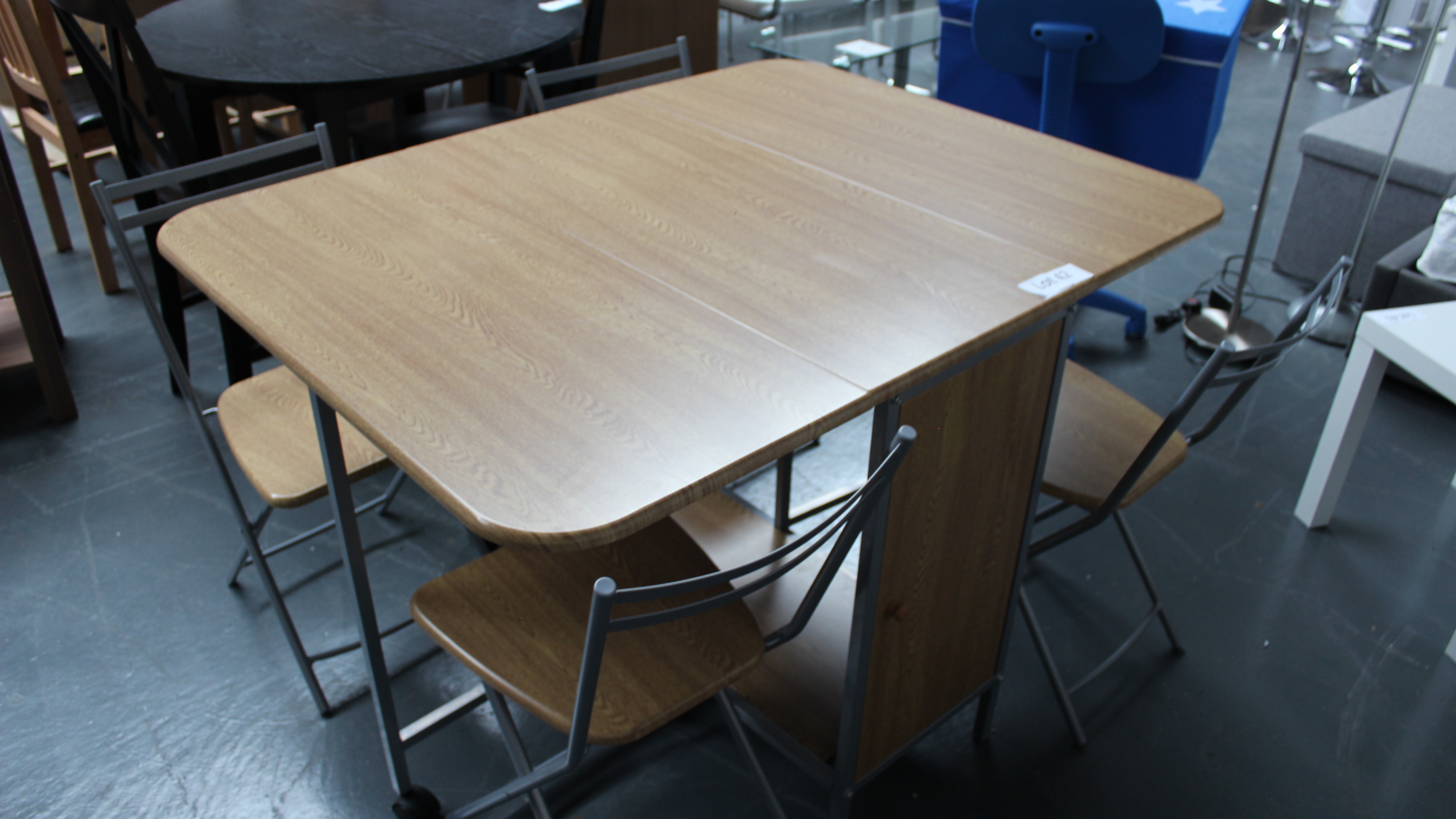 Lot 42 - Folding Storage Table & 4 Chairs. Customer Returns