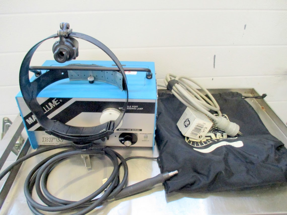Lot 20 - BFW 150-1 Light Source with headgear, handpiece, new bulb and carrying bag.