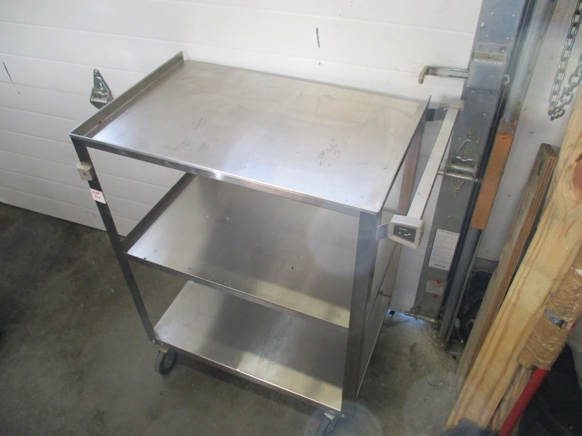 Lot 24 - Stainless Steel wheeled medical cart with shelves.
