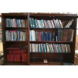 Three and a bit shelves of books including Red Prayer Books