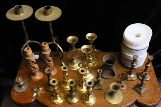 Assorted small candlesticks and candle wax catchers