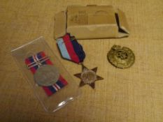 Two World War II medals: The 1939-45 Star and The War Medal and a medal box; together with a Royal