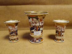 A garniture of three Spode vases, c. 1820, in the Imari palette, the centre vase footed, flanked