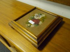 A Victorian needlework inset mahogany coaster, moving on castors. 32cm by 35cm