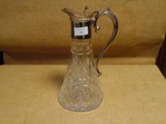 A silver-plate mounted cut-glass claret jug, with leaf-capped scroll handle and tapering cylindrical