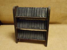 A set of Works of Shakespeare in miniature, thirty-seven volumes, housed in a miniature oak three